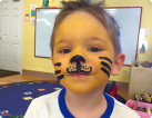 a little boy with a paint on his face